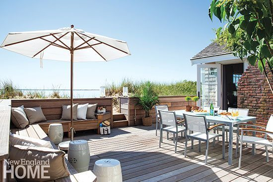Built-in seating along the perimeter of the deck maximizes space for outdoor entertaining.