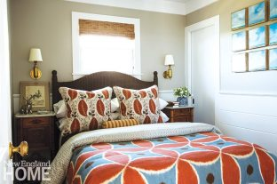 Designer Herbert Acevedo chose bolder colors for the diminutive guest room than elsewhere in the house; visual interest is created by mixing patterns.