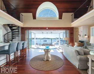 Mahogany on the floor and ceiling bring a boathouse sensibility to the one large interior room, which is furnished with comfortable, hard-wearing fabrics in colors that coordinate with the outdoors.