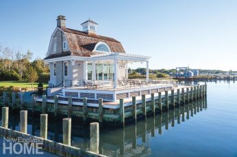 The pool house is essentially perched over the water.