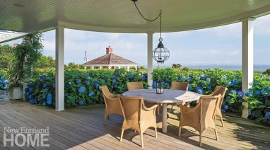 The rounded porch is a favorite destination for al fresco meals.