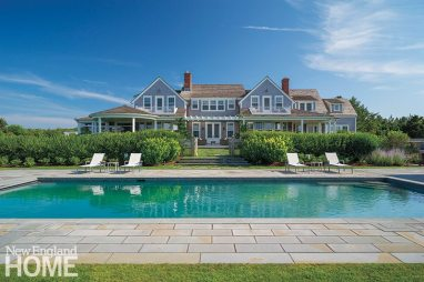Opportunities abound for catching ocean views, including a pair of second-floor roof decks. A honeysuckle hedge (with a safety fence hidden inside) safeguards the pool.
