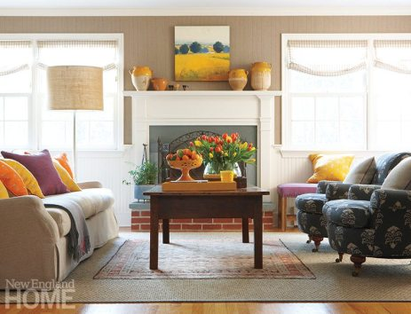 The living room's neutral palette suits husband John's classic tastes, while vivid accents satisfy wife Susie's love of color.