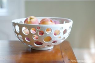 A 9-inch round bowl with holes.
