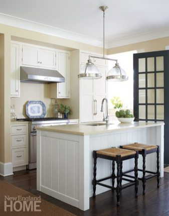 With its white cabinetry and nickel hardware, the kitchen has an appropriately nautical look.
