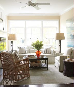 The sofa in the sitting area next to the open kitchen tucks into a new bay window.
