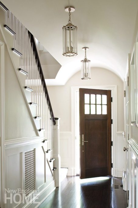When illuminated, faceted glass fixtures cast pleasing patterns on the walls of the entry hall.