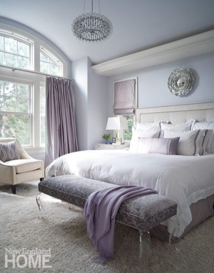 The master suite is a study in glam, with custom furnishings by designer Kat Rosier set against a subtle shade of lavender.