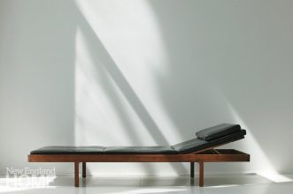 The Daybed, shown here in solid Santos Rosewood with leather cushions, was designed to provide flexible seating options.