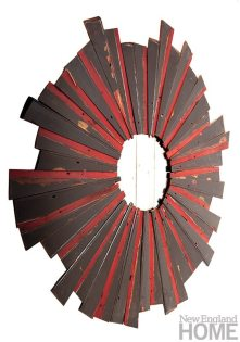 A sunburst mirror fashioned from original cedar clapboard uncovered during the renovation of a Colonial Newport home.