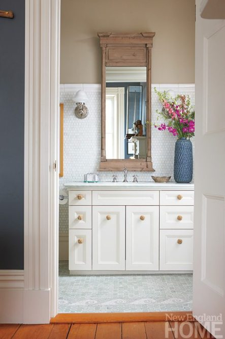 An an aged-look mirror from Restoration Hardware and a new marble top for the vanity enliven the existing tile in the master bath.
