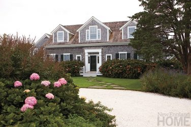The classic Shingle-style house was built in 1996.