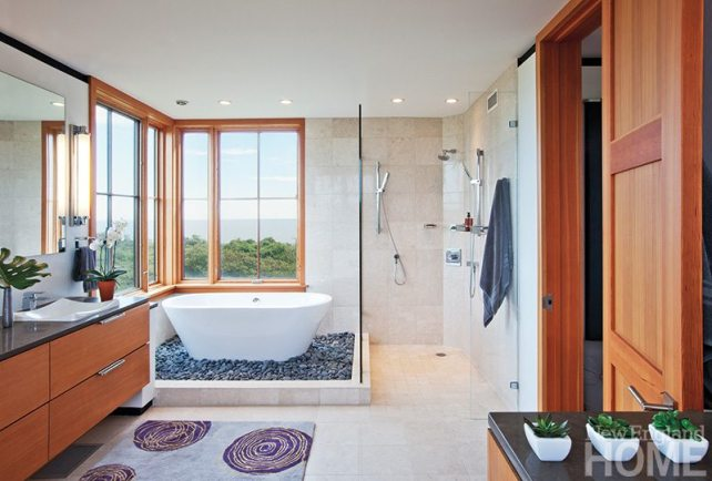 The tub in the master bath rests on a sea of smooth stones.