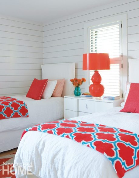 Coral accents spice up a bedroom.