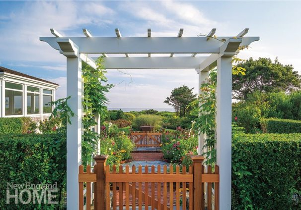 Sightlines were of paramount importance to the landscape design; a pergola in the side garden frames the ubiquitous water view.