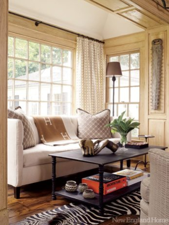 Light spills in on a second, smaller ­sitting area in the family room.