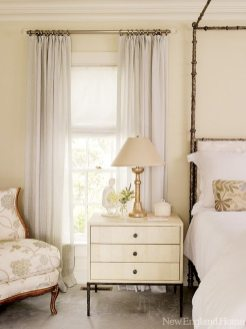 Shades of cream and white give the master bedroom a feminine feel.