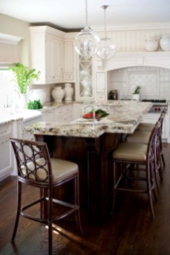 Colonial-style light fixtures and bar stools made way for a more modern interpretation.