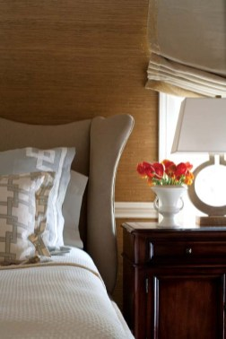 Velvet roman shades and an upholstered headboard add a plush note to the master bedroom.