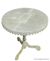 """Tin Patchwork Table """"I love the distressed look of this unique side table. The tin top resembles remnants of old ceiling tiles hammered and pinned into a patchwork pattern."""" Decorative Interiors"""