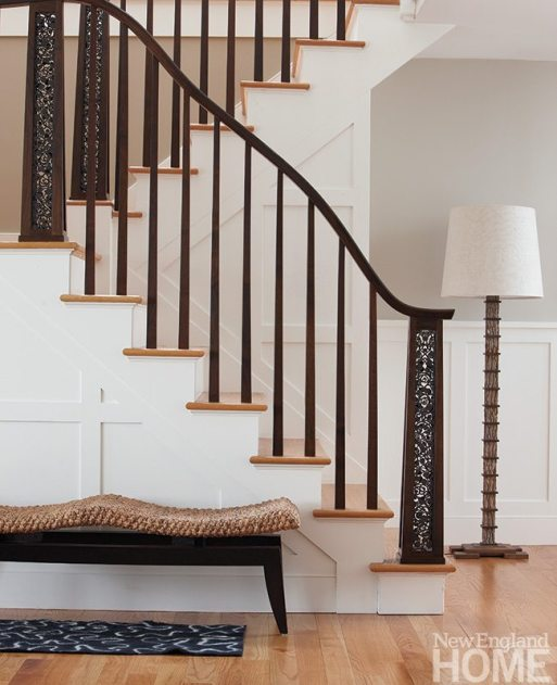 The Arts and Crafts influence takes a contemporary turn in the staircase crafted by Gregory Clark with its serpentine banister and filigree-inset newel posts. The homeowner, an accomplished craftswomen herself, made the felt throw rug.