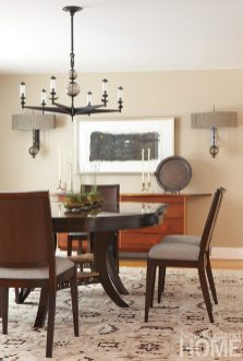 The dining table, which expands to seat two dozen, has an apron of gold coral onyx embellished with metal filigree in an echo of the entry stair.