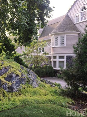 """The enormous rocks that dot the property are indigenous to the area. """"The rocks have a wonderful form that adds to the landscape,"""" says the owner."""
