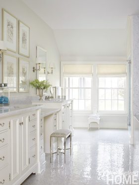 In the posh master bath, honed Carrara marble countertops and polished nickel hardware give the custom vanities an added dash of elegance.