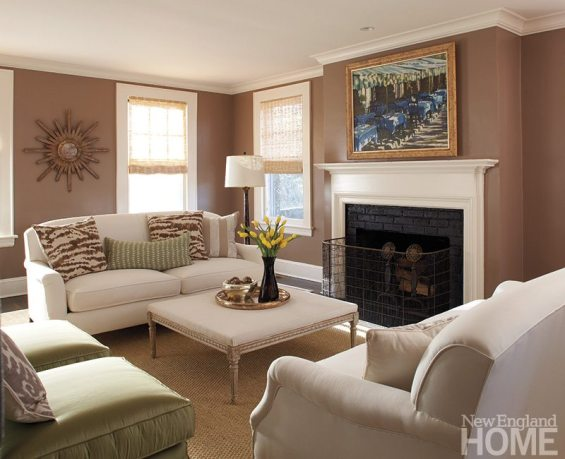 The living room's calm personality speaks with soft brown walls and unfussy window treatments.