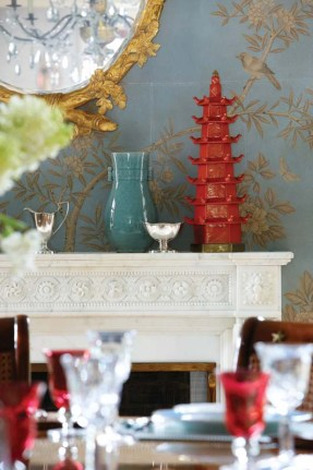 Whimsical chinoiserie directs attention to the dining room mirror.