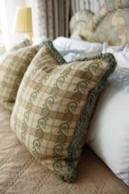 Robert Allen pillows suit the master bedroom.