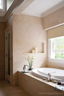 The master bath features a large oval tub by Oceania.