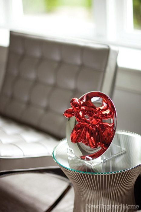 A detail of Red Balloon Dog, by Jeff Koons, in the master bedroom.