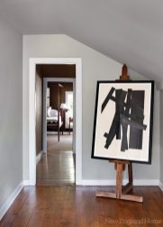 A Jack Sonenberg lithograph lends a punch to the upstairs hall.