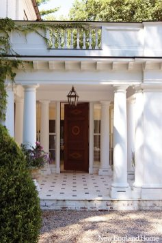 An old-world portico with graphic limestone floors sets the tone for the house. .