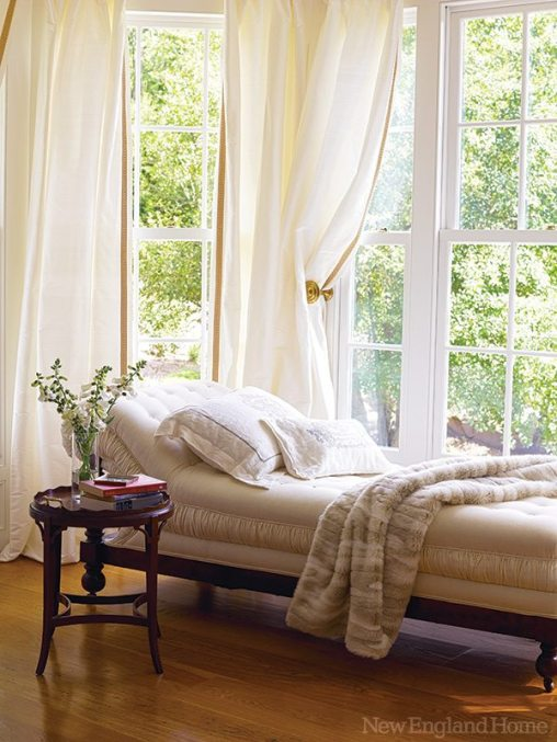 A nineteenth-century chaise longue beckons from the window bay overlooking the garden.