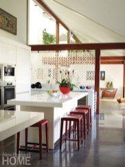 A striking glass screen defines the kitchen.