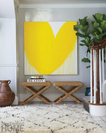 A painting by Kerri Rosenthal hangs on the high-gloss gray walls of the foyer.