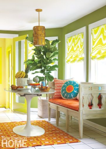 The breakfast nook sounds a wake-up call with walls of tequila lime, a geometric-patterned rug and vivid toss pillows.