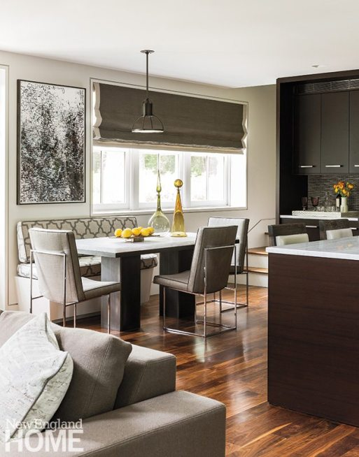 The colors of the open kitchen's custom glass backsplash from Ann Sacks inspired designer Eric Roseff's furniture choices such as the barstools upholstered in cloud-colored all-grain leather from Edelman