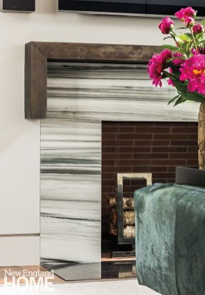 The designer's choices play off the Zebrino marble fireplace surround and bronze mantel designed by Kaehler.