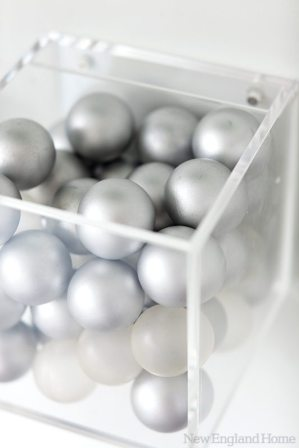 Wall-mounted Lucite boxes hold ping pong balls and paddles.