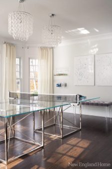 "The palette has a definite ""wow"" factor, with crystal chandeliers, frosted glass, Lucite, mirrors and shiny silver chrome. ""It ups the glamour factor in a really beautiful way,"" says Morgan Harrison of her fondness for reflective surfaces."