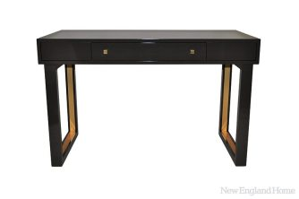 """The """"chelsea"""" desk, of poplar with brass detailing and a deep brown finish called dragon's breath, made its debut in January."""