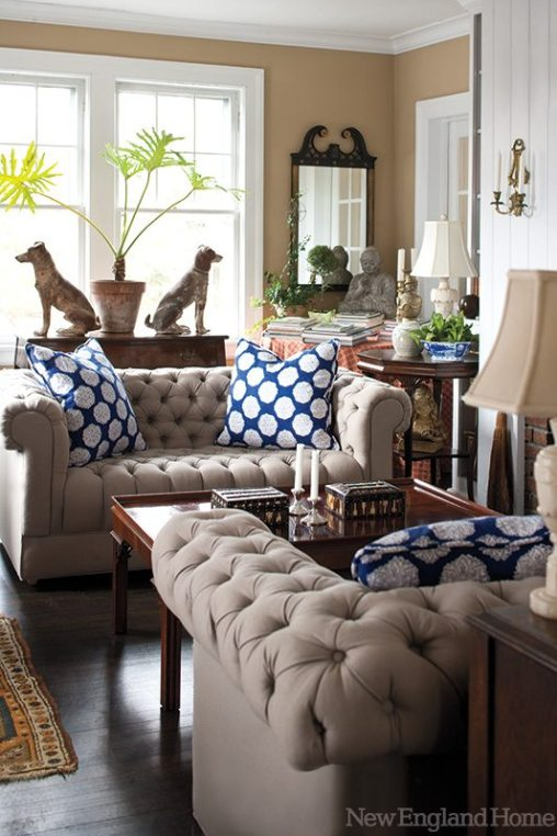 More clever juxtapositions unfold at one end of the living room, where Byrd Swift's vibrant painting teams with an antique tea table and family heirlooms including a rose medallion bowl and silver candlesticks.