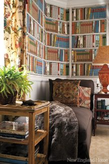 Faux-bookshelf wallpaper by Brunschwig & Fils gives the reading room added personality.