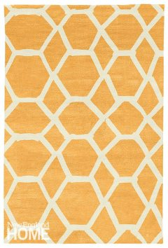 """Jalli by Judy Ross """"With hints of traditional and modern in its color tones of cantaloupe silk and ivory, this rug would form an interesting backdrop for a room that needs a fresh look. I like that rather than perfect shapes, the lines of this geometry look hand-formed and natural."""" Judy Ross Textiles, New York City, (212) 842-1705, judyrosstextiles.com"""