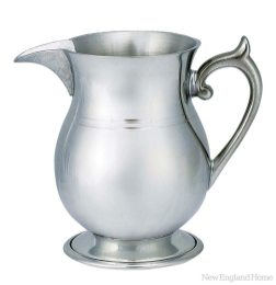 A cider pitcher in the traditional Paul Revere style.