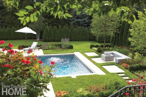 Doyle Herman Design Associates reworked the pool area, reducing the cement around the pool and adding gardens and the fire pit area.