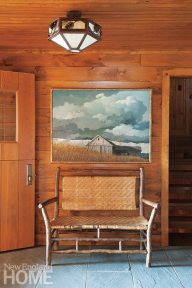 The warmth of wood carries in from the outdoors, enveloping the vestibule.